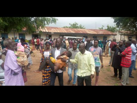 Parents are reunited with released students of the Bethel Baptist High School in Damishi, Nigeria yesterday.