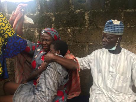 Parents are reunited with released students of the Bethel Baptist High School in Damishi, Nigeria, on Sunday.