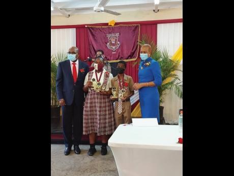 From left: Tourism Minister and Member of Parliament for St James East Central, Edmund Bartlett; Xaria Binns, valedictorian and the top-performing PEP girl at John Rollins Success Primary School; Terrell Morris, John Rollins Primary's top-performing PEP