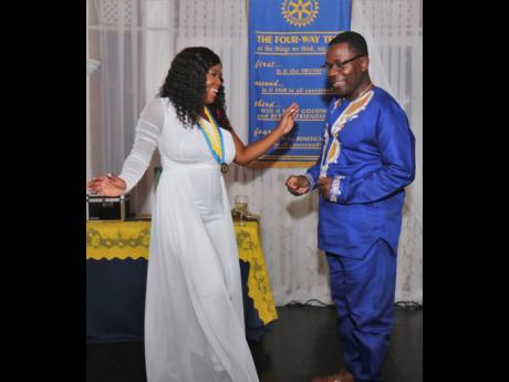 New President of the Rotary Club of Montego Bay, Amber-Gail Grandison, took the dance floor with the outgoing president, Nana Boakye-Agyemang.