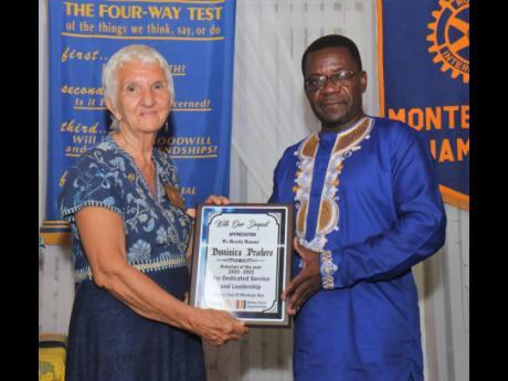 Dominica Pradere receives her award as Rotarian of the Year 2020-2021 from Nana Boakye-Agyemang.