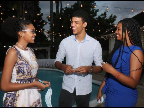 Gabriel Tickle is flanked by Ashley Deans (left) and Imani Peterkin at the Rotary Club of Montego Bay Annual Installation Ceremony last Saturday.
