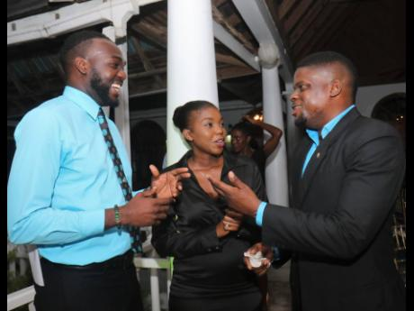 Antonette Taylor is flanked by Ricardo Robinson (left) and Paul Thompson at the Rotary Club of Montego Bay Annual Installation Ceremony on Saturday.