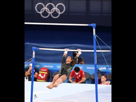 Jamaica's Danusia Francis, with her left foot strapped, competes in the artistic gymnastic event at the Tokyo 2020 Olympics, in the Ariake Gymnastics Centre, Tokyo, Japan, on Sunday. Francis competed despite suffering from an ACL injury.