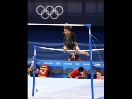 An injured Danusia Francis, with her left leg strapped, competes in the artistic gymnastic event at the Tokyo 2020 Olympics in the Ariake Gymnastics Centre, Tokyo, Japan, on Sunday.