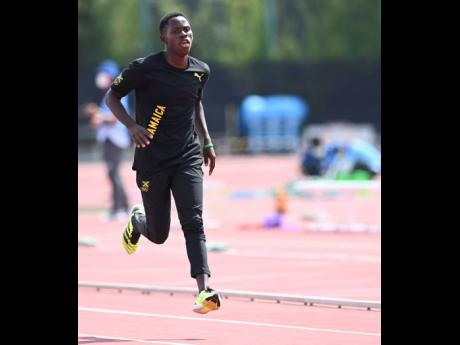 National 100m sprinter Oblique Seville mid-stride during Jamaica's training session at the Tokyo Olympic Stadium's warm up track on Monday.