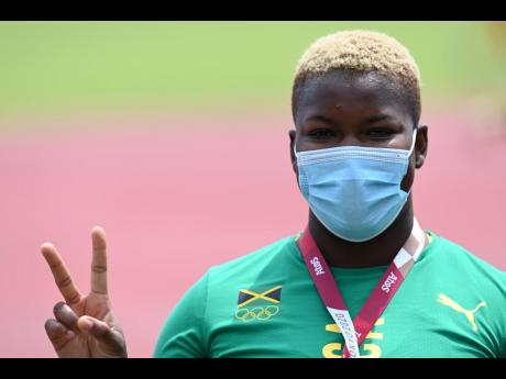 National discus thrower Shadae Lawrence is all smiles for the camera while properly wearing her mask to protect herself from COVID-19.