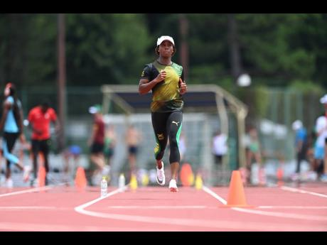National 100m record holder Shelly-Ann Fraser-Pryce is mid-stride in her training drill.