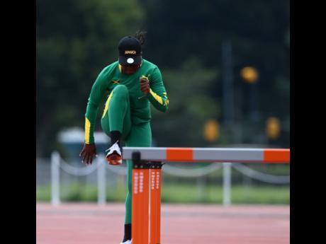 Sprint hurdler Yanique Thompson doing stride practice.
