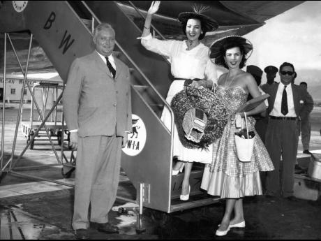 Reluctant goodbyes were the order of the day when film stars Linda Darnell and Ann Miller said their au revoirs at Palisadoes Airport November 14 1955. Both girls were wearing typical Jamaican hats.