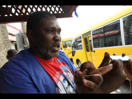"""Damion, a bus operator, is concerned that revenues are being whittled away by the pandemic: """"When yuh check that, nothing nuh lef. Wah di boss get? Weh me get as di driver? Weh di conductor get?"""" he questioned."""