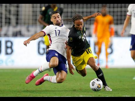 United States midfielder, Sebastian Lletget (17) and Jamaica forward, Bobby Reid (10), battle for the ball during their CONCACAF Gold Cup quarter-finals soccer match at the AT&T Stadium in Arlington, Texas, on Sunday night. United States won 1-0. (AP Photo