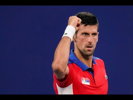 Novak Djokovic, of Serbia, celebrates during a second round tennis match against Jan-Lennard Struff, of Germany, at the 2020 Summer Olympics in Tokyo, Japan on Monday.