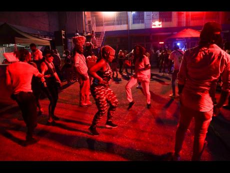 A woman is the centre of attention among patrons at the Uptown Mondays party at Savannah Plaza on Constant Spring Road last night. Prime Minister Andrew Holness did not impose a ban on entertainment events as many Jamaicans had anticipated.
