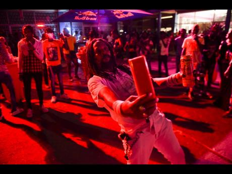 Partygoer and fruit vendor 'Cyah Tiad' takes a selfie during the popular Uptown Mondays party at Savannah Plaza on Constant Spring Road last night.
