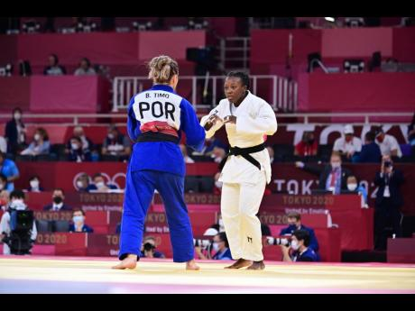 National judoka Ebony Drysdale Daley (right) faces off against Portugal's Barbara Timo in Women's 70kg Judo Round of 32 Elimination action at the Olympic Games, at the Nippon Budokan field of play in Tokyo, Japan on Tuesday night, Jamaica time.