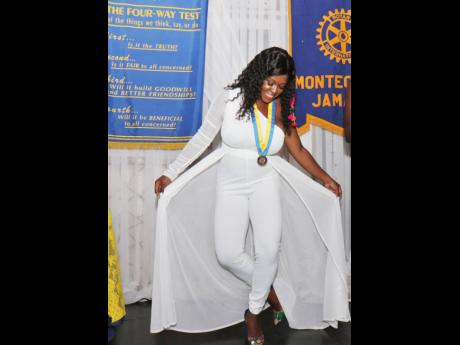 Amber-Gail Grandison, the newly installed president of the Rotary Club of Montego Bay, takes a bow after her official installation into the position  during the annual installation ceremony, held at Day-O Plantation Restaurant & Bar on Saturday evening.