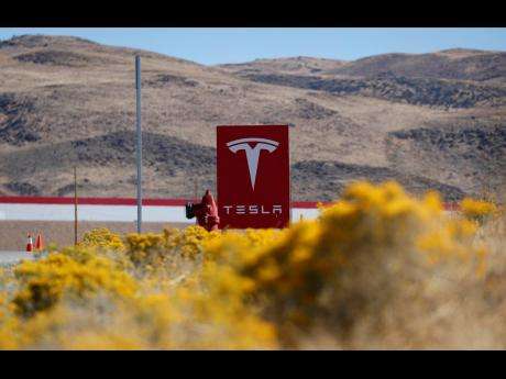 A sign marks the entrance to the Tesla Gigafactory in Sparks, Nevada.