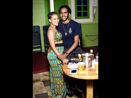 10A Kingston's Property Manager Brianne Stewart is accompanied by Duane-Anthony Davidson, brand strategist at Engine Room Brand House, at Don Dada's dancehall art show.