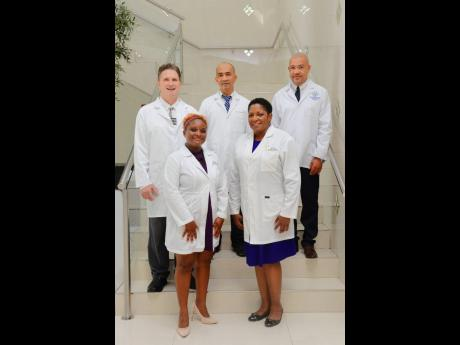 Members of the i-doc Concierge Wellness Serviced Limited team: front from left, Dr Sherridene Lee, managing director, and Dr Jacqueline Chambers, director; and back from left, Dr Witold Radomski, director, Dr Alvin Wong, partner doctor, and Dr Garfield Cha