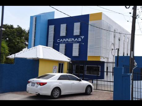 The Carreras head office located at Ripon Road in St Andrew. The cigarette distributor said that proposed legislation would imperil the offer of scholarships to needy students.