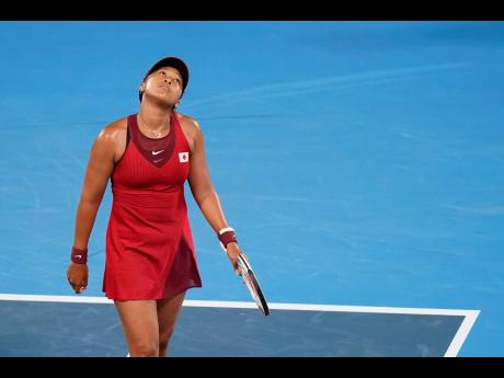 Naomi Osaka, of Japan, reacts during a third round women's tennis match against Marketa Vondrousova, of the Czech Republic, at the 2020 Summer Olympics in Tokyo, Japan on Tuesday.