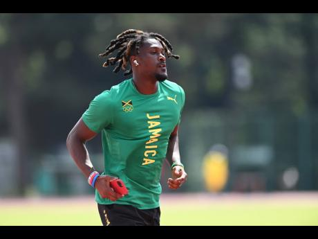 Sprint hurdler Damion Thomas during a training session at the Olympic Stadium warm-up track in Tokyo, Japan on Monday.