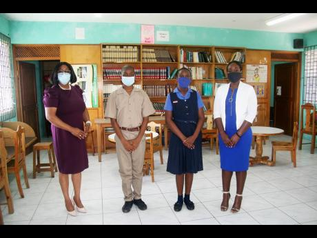 From left: Jasmin Johnson, principal of Bethel Primary School in Hopewell, Hanover; Jordaine Evans, the school's top performing boy in the recent PEP examinations; Almonique Hutchinson, the top performing girl, and chairman of the school's board of gov