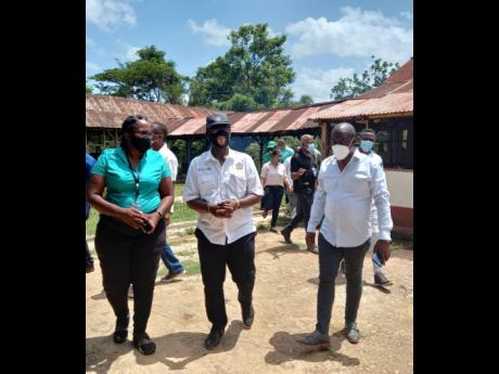 From left: Councillor of the Porus divison Claudia Morant-Baker, Minister of Local Government and Rural Developmemt Desmond McKenzie, and Mayor of Mandeville Donovan Mitchell during a tour of the Porus division recently.