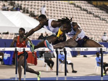 Hansle Parchment (left) competing in the semi-finals of the men's 110m hurdles event at the National Senior Championships at the National Stadium in St Andrew on Saturday, June 26.