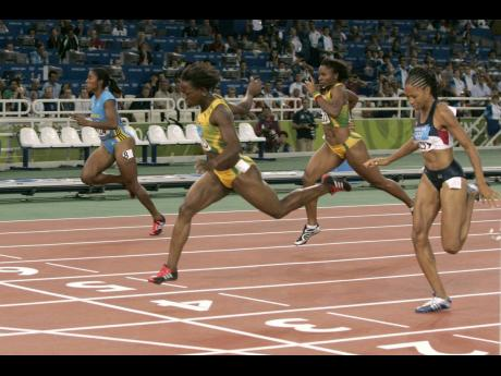 Jamaica's Veronica Campbell (second left) crosses the finish line ahead of Bahamas' Debbie Ferguson (left), Jamaica's Aleen Bailey (second right), and Allyson Felix of the United States to win the women's 200m final at the Athens 2004 Olympic Games