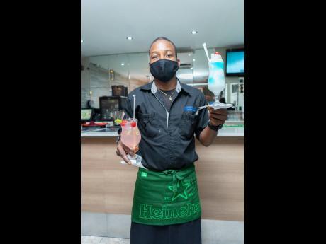 Jamaica Liquor Warehouse server, Franz Lamont, gave out ice-cold, mixed drinks.Jamaica Liquor Warehouse server, Franz Lamont, gave out ice-cold, mixed drinks.Jamaica Liquor Warehouse server, Franz Lamont, gave out ice-cold, mixed drinks.Jamaica Liquor Ware