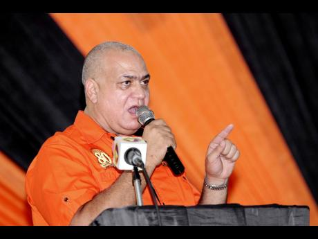 PNP vice-presidential nominee Richard Azan addresses party supporters at a constituency conference at Manchester High School on Saturday.