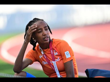 The Netherlands' 5000m and 10,000m runner Sifan Hassan takes a break from training at the Olympic Stadium Warm-up Track in Tokyo, Japan, on Tuesday.