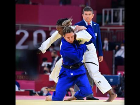 Jamaican judoka (competitor in judo) Ebony Drysdale-Daley in action against Portugal's Barbara Timo in the Women's 70kg Elimination Round of Judo at the Tokyo 2020 Olympics at Nippon Budokan in Tokyo, Japan, on Wednesday.