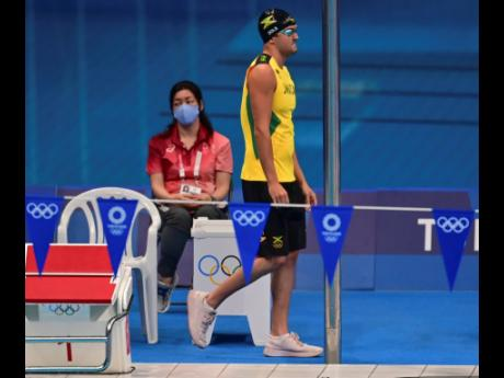 Jamaican swimmer Keanan Dols approaches the pool at the Tokyo Aquatics Centre to prepare for the men's 200m Individual Medley on Wednesday.