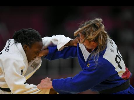 Jamaica's Ebony Drysdale-Daley competes against  Portugal's Barbara Timo in the women's -70kg elimination round of judo at the Nippon Budokan during the Tokyo 2020 Olympics on Wednesday. Drysdale Daley, who lost to Timo, is Jamaica's first Olympian