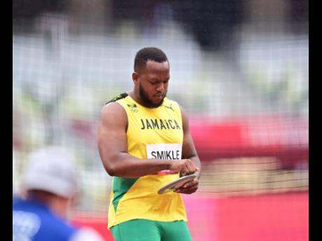 Jamaica's Traves Smikle competing in the Men's Discus Throw qualification event at the Tokyo 2020 Olympics at the Tokyo Olympic Stadium in Tokyo, Japan on Friday, July 30, 2021.