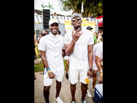 Jay Enigma (left), on tour with his client, the fastest man alive, Usain Bolt.