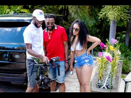 Jay Enigma (left) pictured filming and directing Lia Caribe's music video. He is joined by Nugent 'NJ' Walker (centre), a member of the A-Team and Usain Bolt's executive manager, and Lia Caribe.