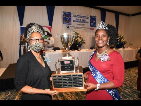 Professor Rosalea Hamilton (left), CEO of the LASCO Chin Foundation, presents the winning trophy to Lillian Lewis McDonald, Nurse of the Year 2021.
