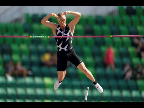 In this June 21, 2021 file photo, Sam Kendricks competes during the finals of the men's pole vault at the United States Olympic track and field Trials in Eugene, Oregon.