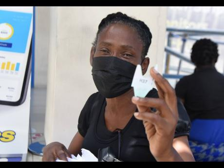 Moreen Stewart was upset about the pace of customer service at JPS's Ruthven Road office on Thursday.