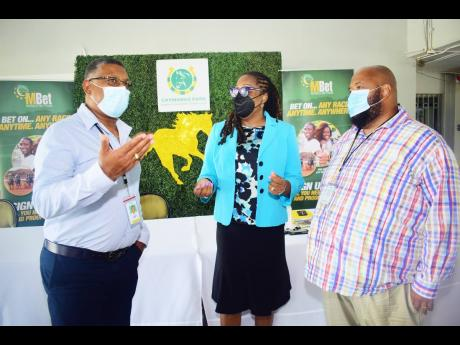 Denzil Miller (left), Racing Secretary, Supreme Ventures Racing and Entertainment Limited (SVREL), talks with Solomon Sharpe (right), Executive Chairman, SVREL and Lorna Gooden,  General Manager, SVREL), during the press conference to announce details of t