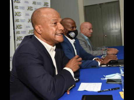 Peter Bunting (left), opposition spokesman on national security, addresses journalists during the Crime Monitoring and Oversight Committee (CMOC) briefing on Thursday. Looking on are Lloyd Distant Jr (centre), CMOC chairman, and George Overton, committee m