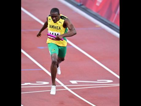 Jamaica's Karayme Bartley on the anchor leg of the Mixed 4x400m Relay event at the Tokyo Olympics in Tokyo, Japan on Friday.