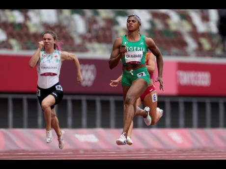Blessing Okagbare, of Nigeria, wins a heat in the Women's 100m sprint at the 2020 Summer Olympics in Tokyo, Japan on Friday.