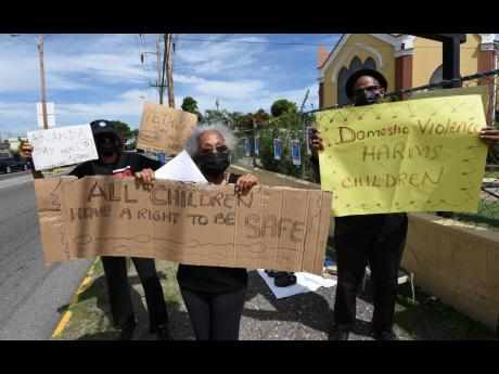 Caroline Dyche (left), No Nine-Day Wonder group member; Yvonne McCalla Sobers (centre), human rights advocate; and Albert Edwards (right), director, Brotherhood of St Andrew, during a protest against gender-based violence, in Liguanea, St Andrew on Thursda