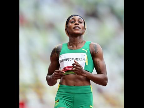 Jamaica's Elaine Thompson-Herah competes in her heat in the Women's 100m event at the Tokyo 2020 Olympic Games held at the Tokyo Olympic Stadium in Tokyo, Japan.