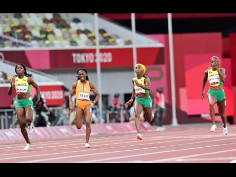 (From left) Jamaica's Shericka Jackson, the Ivory Coast's Marie-Josee Ta Lou, Jamaica's Shelly-Ann Fraser-Pryce and Elaine Thompson Herah compete in the Women's 100m final at the Tokyo 2020 Olympic Games held at the Tokyo Olympic Stadium in Tokyo, Japan on